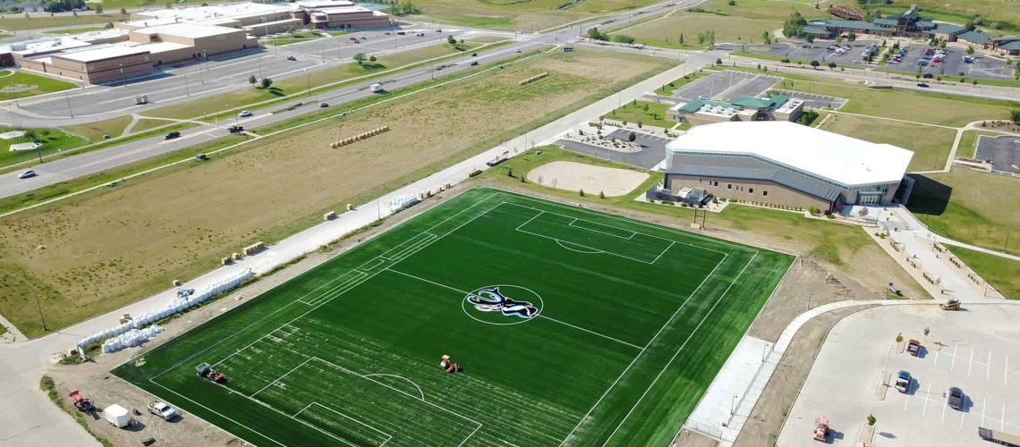 soccer field being completed by special equipment